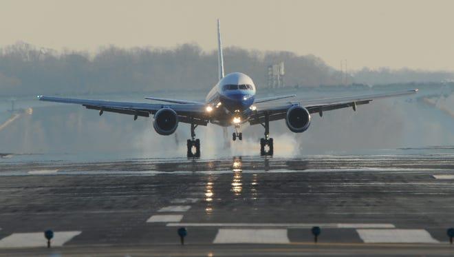 A plane lands at Washington Reagan National Airport.