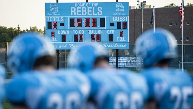 The South Burlington football team gathers on the sidelines at the start of a game against CVU in South Burlington on Friday, September 4, 2015.