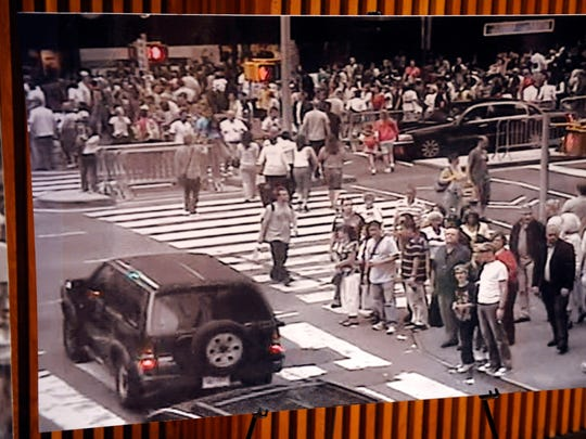 In this file photo of Sunday, May 2, 2010 at a NYPD news conference in New York, a still photo from a surveillance camera shows a bomb-laden Nissan Pathfinder driving through crowds of people in Times Square on Saturday evening May 1, 2010.
