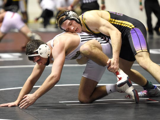 Biglerville's Scott Cooper attempts to break free from Boiling Spring's AJ Kostyak in the 145-pound final at the District 3 Class AA wrestling championships Saturday at Hersheypark Arena. Kostyak won, 3-1.