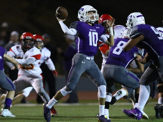 Shasta High quarterback Ian Garcia (10) looks for an