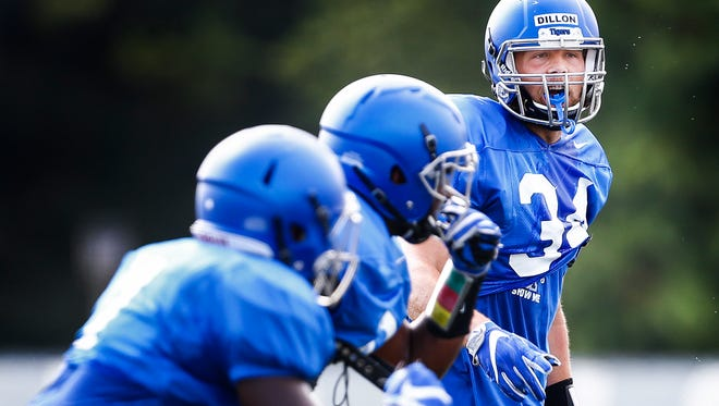 University of Memphis linebacker Jackson Dillon (right) runs through drills during a recent practice.
