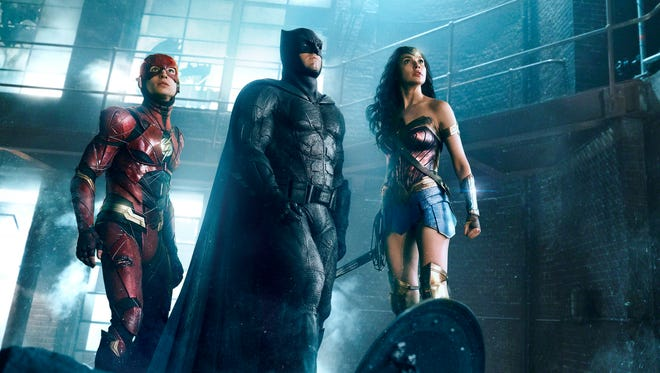 "Ezra Miller (as The Flash, from left), Ben Affleck (Batman) and Gal Gadot (Wonder Woman) are ready for action in Zack Snyder's new cut of ""Justice League."""
