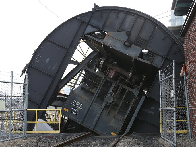 After 121 years of receiving and burning coal, the final load of coal will be emptied at Citizens Perry K Coal Yard Monday, March 10. Once the final tons of coal are burned in mid-March, Perry K will burn only natural gas. Here the final coal car is dumped.