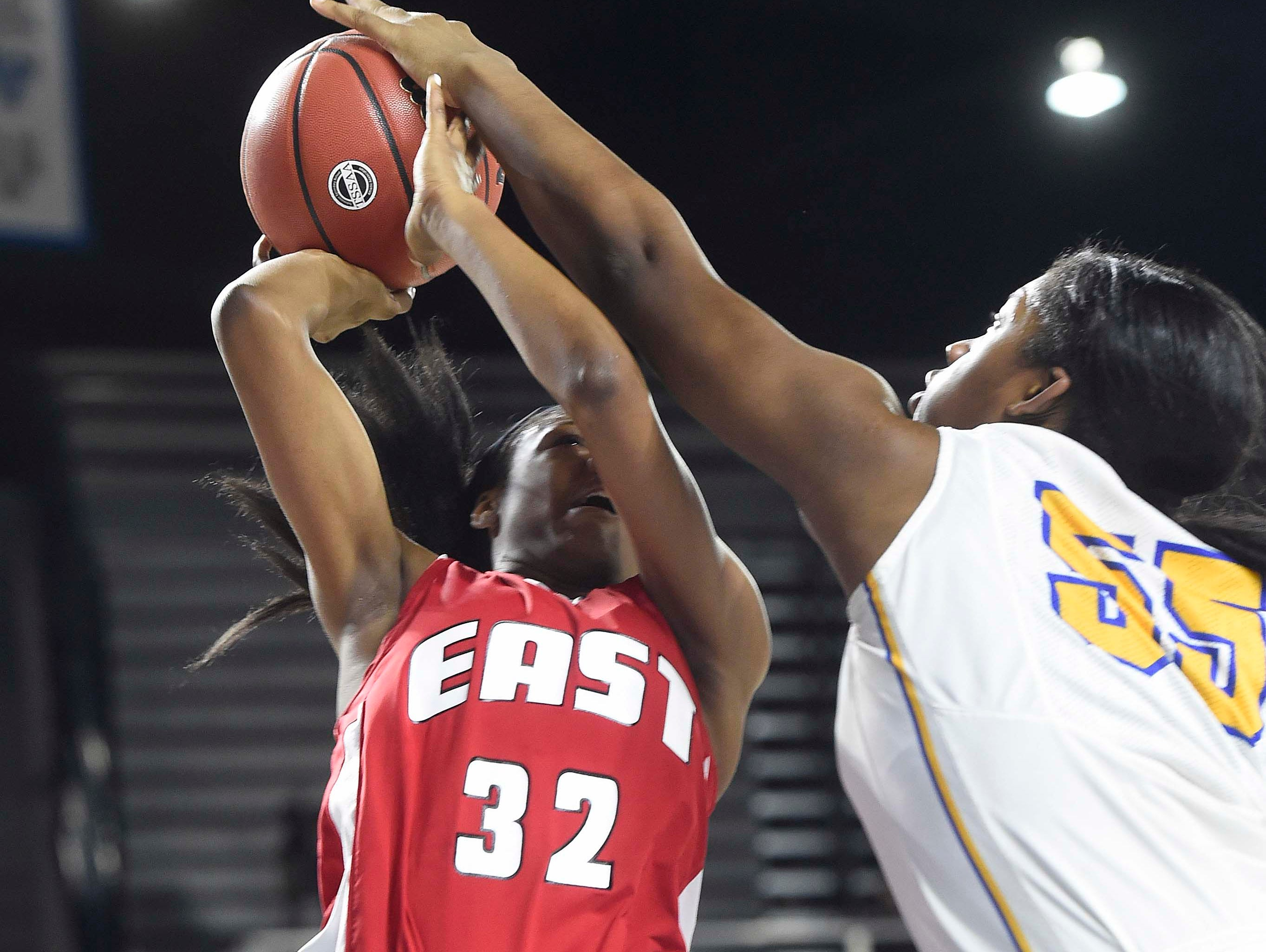 East's Quentarra Mitchell (32) is blocked by Westview's Deja Grraves (55) as Westview High School leads 17-13 East Nashville at the half in the Division I Class AA Girl's basketball semi-finals at the Murphy Center on MTSU's campus March 11, 2016 in Murfreesboro, Tenn.