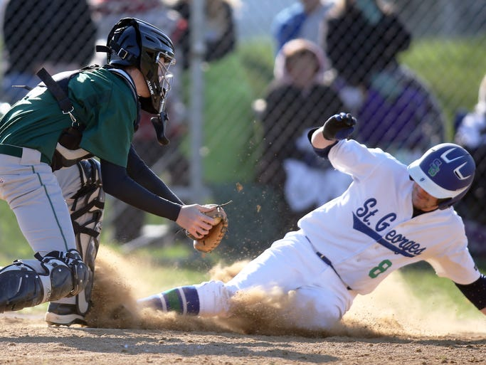 St. Georges's Shane Feehery scores the first run of the game as he beats a throw to Mount Pleasant catcher Mike Forwood as the Hawks jump out to a lead in the second inning of Mount Pleasant's win at St. Georges Technical High School, Wednesday, April 16, 2014.