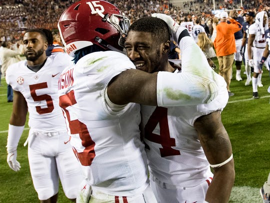 Alabama defensive back Ronnie Harrison (15) consols