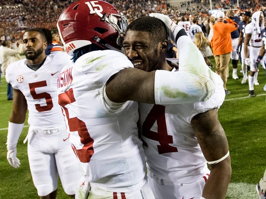 Alabama defensive back Ronnie Harrison (15) consols Alabama defensive back Deionte Thompson after the Iron Bowl in Auburn, Ala. on Saturday November 25, 2017.
