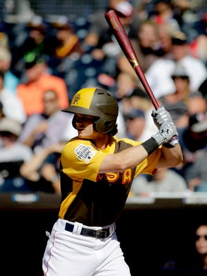 U.S. Team's Andrew Benintendi, of the Boston Red Sox, hits against the World Team during the first inning of the All-Star Futures baseball game, Sunday, July 10, 2016, in San Diego.