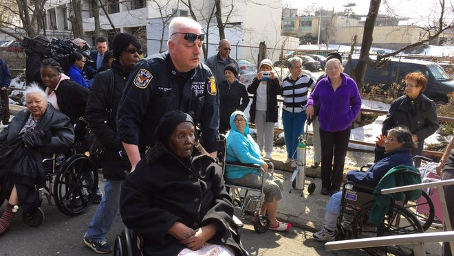 Police assist residents of the senior citizens apartments at 95 and 97 Walsh Road in Yonkers after a mudslide forced an evacuation of the building Wednesday afternoon.