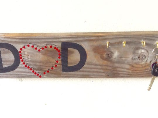 Turn a scrap piece of wood and some stencils into a place for Dad to display his grill utensils or to just stash his keys.