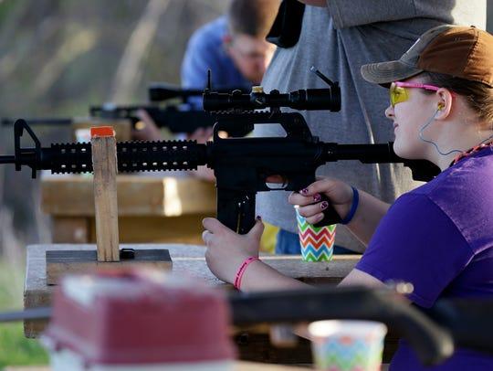 Abby Sandvick, 14, of Toledo, Iowa, shoots during a