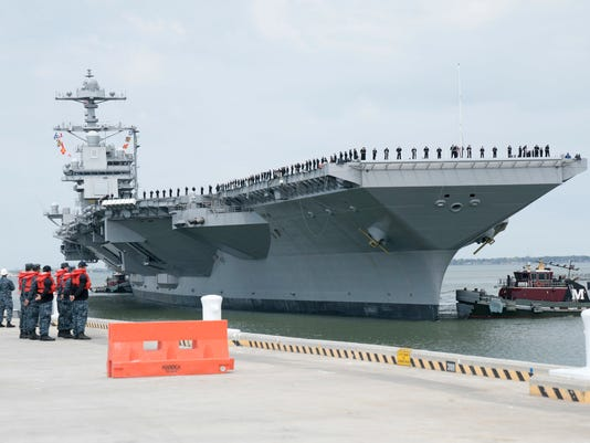 The future USS GERALD R. FORD (CVN 78) arrives at Naval Station Norfolk