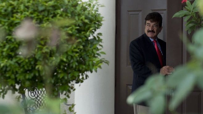 Seddique Mateen, father of Orlando shooter Omar Mateen, enters a home on Bayshore Boulevard in Port St. Lucie on June 15.
