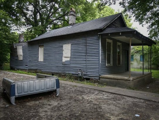 The boarded-up house at 406 Lucy Ave., in Memphis,