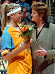 UT head coach Pat Summitt presents flowers to senior Brittany Jackson before the Mississippi State game in 2005.