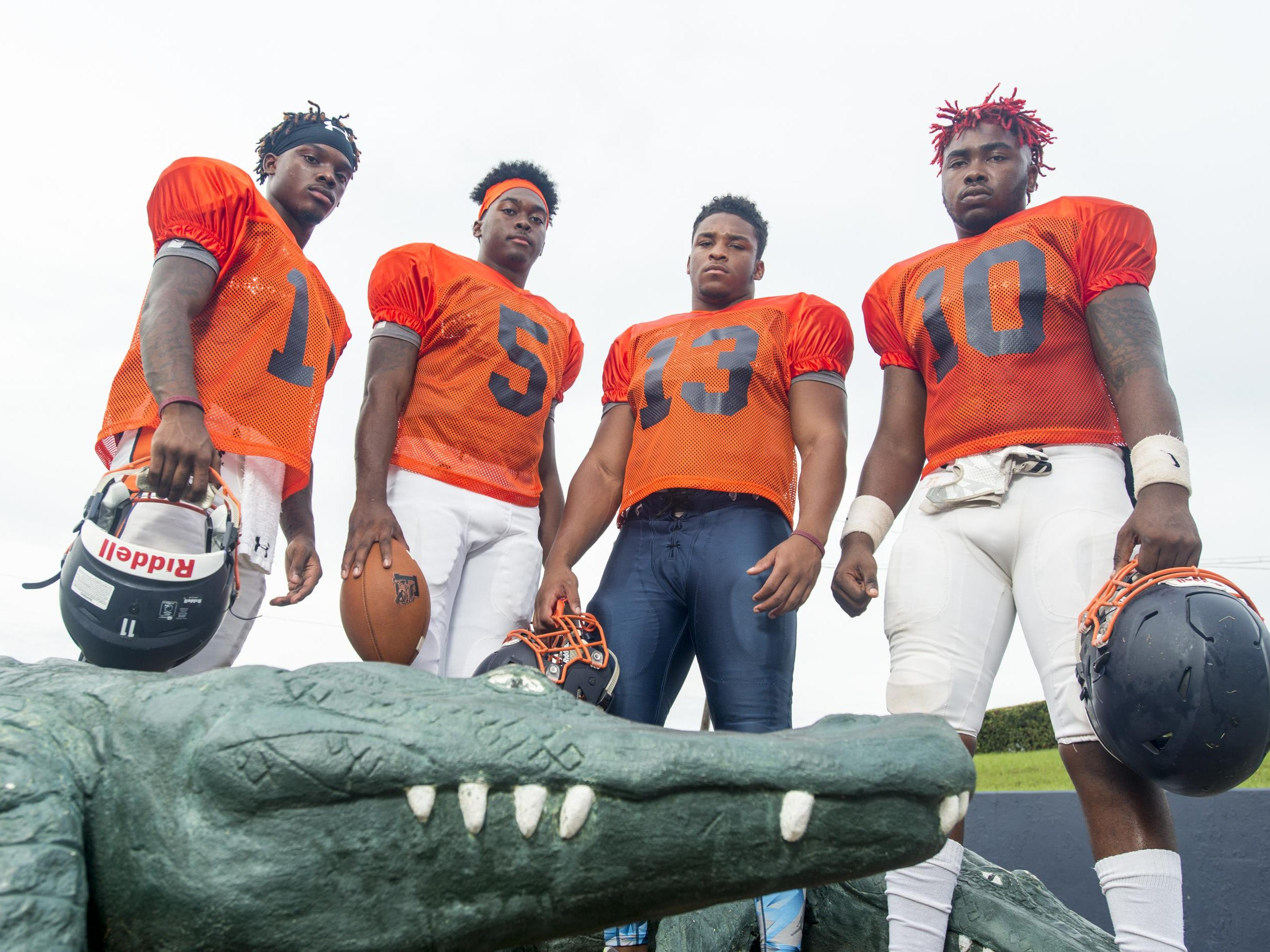 Football players (left to right) Martin McGhee (11), Z'khari Blocker (5), Shountrell Hills (13), and Amarquez Moore (10) at Escambia High School in Pensacola, FL on Monday, August 8, 2016.