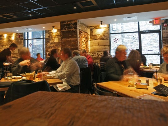 Patrons eat lunch at Taverna, an Italian eatery from