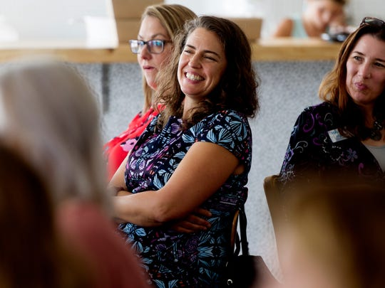 Indya Kincannon laughs during a Lady Bosses of Knoxville roundtable discussion at The Hive on women working in the food industry on Aug. 2, 2017. About 30 women attended the roundtable discussion to hear from four local female business owners.