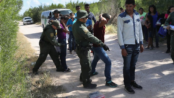U.S. Border Patrol agents take a group of Central American asylum seekers into custody on June 12, 2018, near McAllen, Texas.