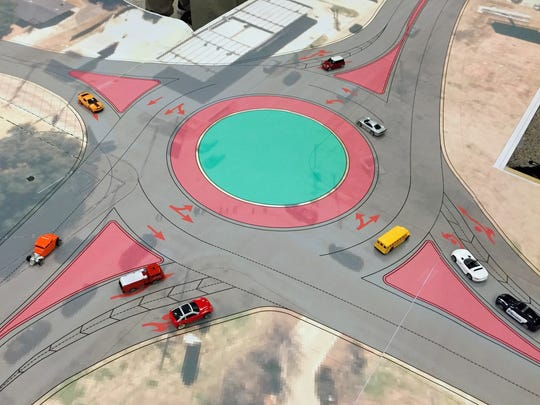 A display of a roundabout that is proposed at the intersection of Jackson Street Extension and Versailles Boulevard.