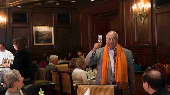 Ajit George, founder of the MidAtlantic Wine + Food Festival, toasts guests gathered in the Green Room of the Hotel du Pont in 2013.