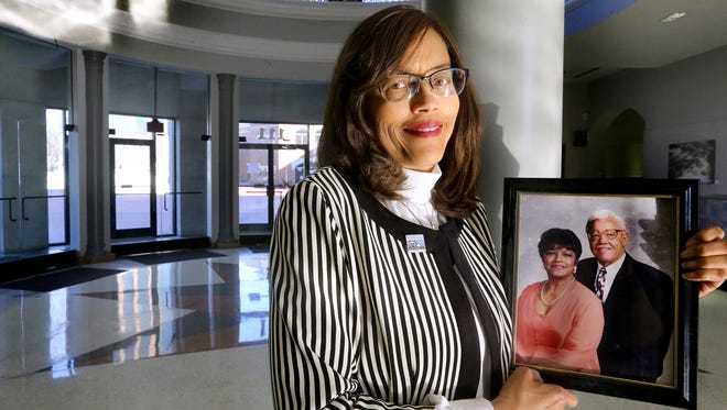Madelyn Scales Harris the new Murfreesboro Vice-Mayor holds a photograph of her parents Robert and Mary Scales. Photo taken in the rotunda at City Hall on Friday, Feb. 17, 2017.