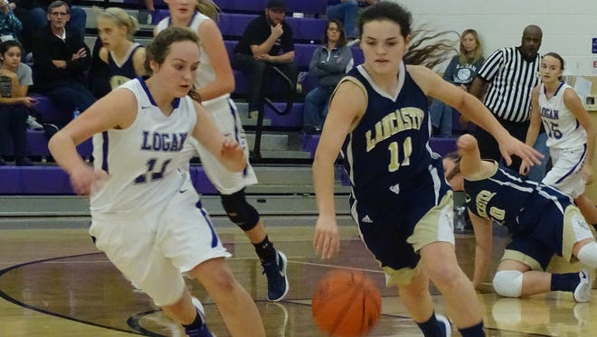 Lancaster junior Alexis Matheney drives past a Logan defender during Tuesday's nonconference game. The Golden Gales won 39-36 to improve to 2-0 on the season.