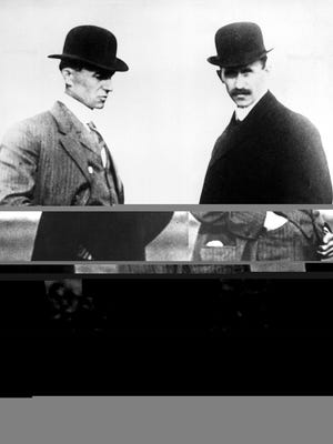 Wilbur Wright, left, and his brother, Orville, wear bowler hats in this undated photo. The Wright brothers worked together to build the first airplane to make a successful flight, on Dec. 17, 1903, at Kill Devil Hills near Kitty Hawk, N. C.