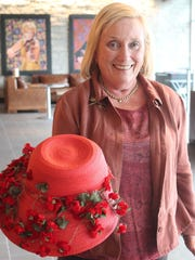 Patricia Wallace, president of the Nashville Tree Foundation, holds the hat that the late Betty Brown wore to NTF events when she was the organization's president.