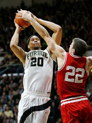 A.J. Hammons puts up a shot over Ethan Happ of Wisconsin Sunday, March 6, 2016, at Mackey Arena. Purdue defeated Wisconsin 91-80.