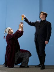 """Elijah Martinez, left, and Jackson Richmond rehearse a scene in University Preparatory High School's production """"Imaginary Invalid"""" by Moliere on Monday, May 2, 2016."""
