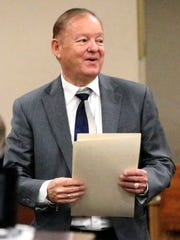 """Judge William """"Bill"""" Moody receives a resolution before County Commissioners Court honoring his more than 30 years of elected service to the county."""