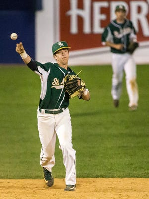 St. Mark's Brian Gilardi throws to first in Salesianum's 5-4 win over St. Mark's at Frawley Stadium in Wilmington on Tuesday night.