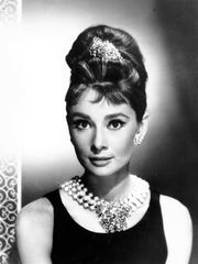 Actress Audrey Hepburn poses as Holly Golightly in the 1961 movie Breakfast at Tiffany's. A Millburn dress shop says its designs are inspired by Hepburn.
