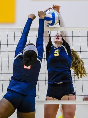 DeWitt's Grace George ,9, blocks the ball back over the net in a match last fall. The senior has been one of the key components for the No. 7-ranked Panthers.