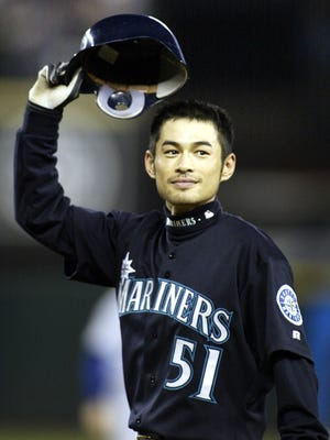 Ichiro Suzuki tips his hat to the fans after breaking the single-season hit record in 2004.