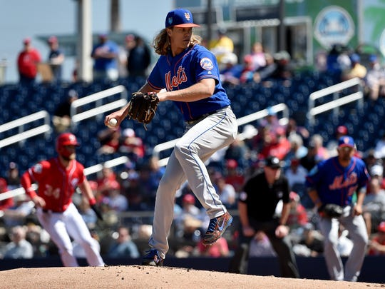 New York Mets starting pitcher Noah Syndergaard (34) delivers a pitch against the Washington Nationals during a spring training game at The Ballpark of the Palm Beaches.
