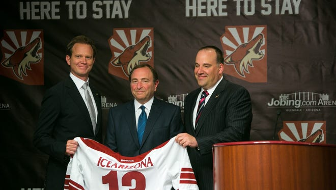 NHL Commissioner Gary Bettman, middle, introduces new Coyotes owners George Gosbee, left, and Anthony LeBlanc.