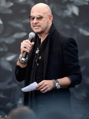 Designer John Varvatos speaks at the John Varvatos Boutique on Sept. 21, 2014, in West Hollywood, Calif.