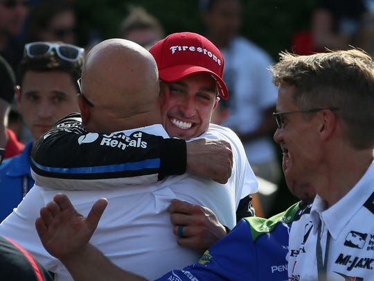 Graham Rahal hugs his father Bobby Rahal before he