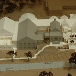 A model of the Cromaine District Library as it would be expanded as a result of the bond issue on the ballott May 5. The existing building is shown in gray; the white portion of the model is the expansion.