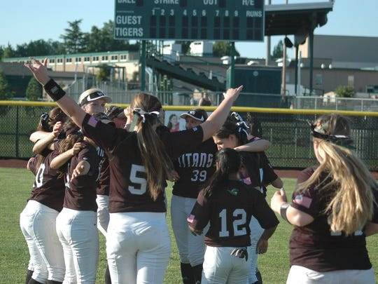 The West Salem High softball team celebrates a 3-0 Class 6A second round state playoff win over Tigard Wednesday at Tigard High School.