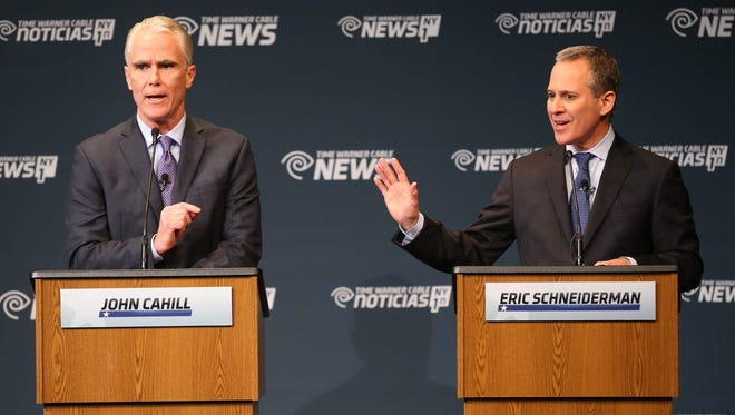 Attorney General candidates John P. Cahill, left, and incumbent Eric Schneiderman participate in a debate at Hilbert College in Hamburg, N.Y. on Thursday, Oct. 30, 2014. (AP Photo/The Buffalo News, Mark Mulville)