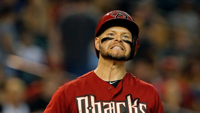 Arizona Diamondbacks' Cody Ross reacts to a called strike in the sixth inning during a baseball game against the San Diego Padres, Sunday, Sept. 14, 2014, in Phoenix.