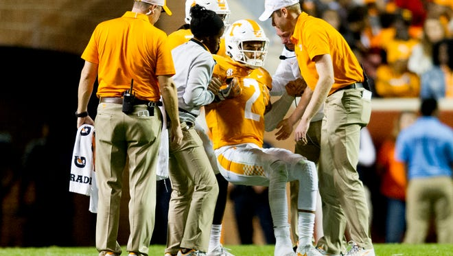 Tennessee quarterback Jarrett Guarantano (2) is helped up after being shaken up by a play during an game between Tennessee and Southern Miss at Neyland Stadium in Knoxville, Tennessee, on Saturday, Nov. 4, 2017.