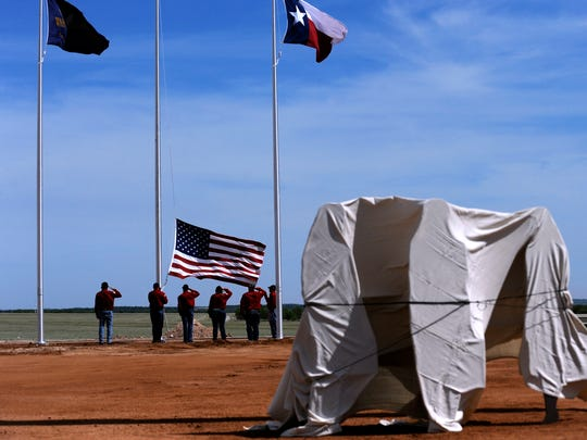 An honor guard salutes as the American flag is raised during the dedications ceremony for Hangar No. 1 at Avenger Field in Sweetwater Thursday May 25, 2017. The building is a replica of the original hangar which trained the Womens Airforce Service Pilots during World War II and is part of the National WASP World War II Museum.