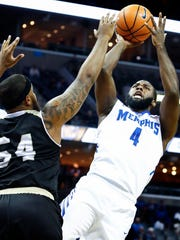 Memphis forward Raynere Thornton (right) puts a shot against Bryant defender Sabastian Townes (left) during first half action at the FedExForum in Memphis Tenn., Saturday, December 9, 2017.