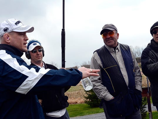 Penn State wrestling coach Cael Sanderson talks with the York Traditions Bank team during the annual Penn State York Clay Shoot at Central Penn Sporting Clays in Wellsville on Thursday.