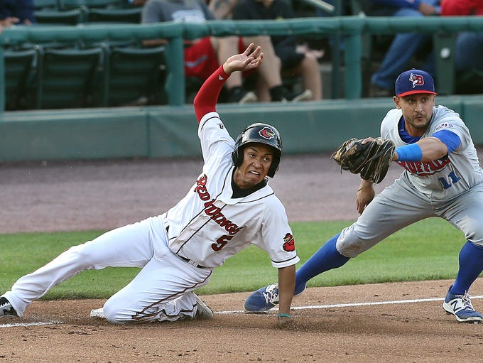 Red Wings Engelb Vielma slides into third base ahead